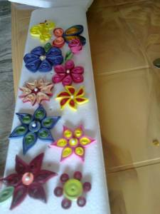 Earrings made by paper quilling